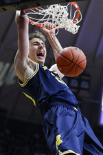 Michigan guard Franz Wagner (21) gets a dunk against Purdue during the first half of an NCAA college basketball game in West Lafayette, Ind., Saturday, Feb. 22, 2020. (AP Photo/Michael Conroy)