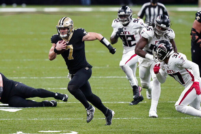 New Orleans Saints quarterback Taysom Hill (7) carries past Atlanta Falcons free safety Ricardo Allen (37), defensive end Steven Means (55) and defensive end Charles Harris (92) in the second half of an NFL football game in New Orleans, Sunday, Nov. 22, 2020. (AP Photo/Butch Dill)