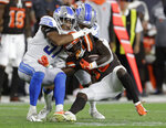 Detroit Lions linebacker Anthony Pittman (57) helps tackle Cleveland Browns running back D'Ernest Johnson (30) during the second half of an NFL preseason football game Thursday, Aug. 29, 2019, in Cleveland. (AP Photo/Ron Schwane)