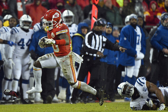 Kansas City Chiefs wide receiver Tyreek Hill (10) loses his shoe as he runs past Indianapolis Colts linebacker Anthony Walker (50) during the second half of an NFL divisional football playoff game against the Indianapolis Colts in Kansas City, Mo., Saturday, Jan. 12, 2019. (AP Photo/Ed Zurga)