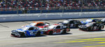 CORRECTS TO REDDICK NOT REDDCIK - Tyler Reddick (2) leads the race in the final laps of a NASCAR Xfinity Series auto race at Talladega Superspeedway in Talladega, Ala., Saturday, April 27, 2019. (AP Photo/Julie Bennett)