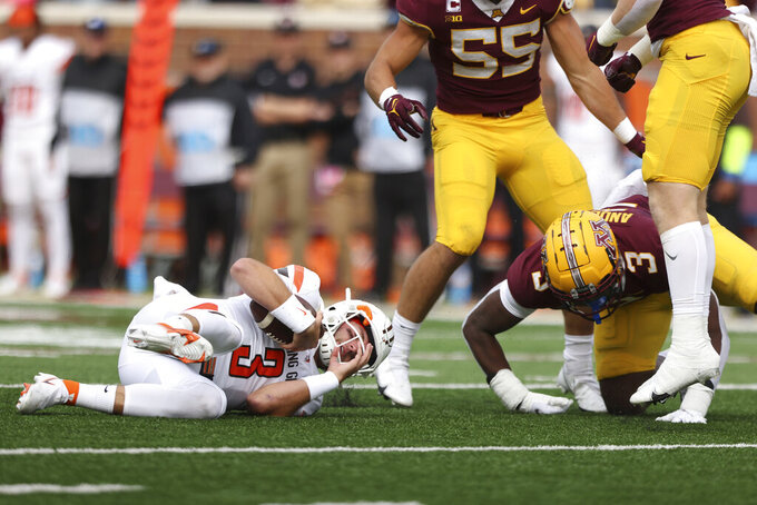 Bowling Green quarterback Matt McDonald (3) is sacked by Minnesota defensive lineman MJ Anderson (3) during an NCAA college football game Saturday, Sept. 25, 2021, in Minneapolis. (AP Photo/Stacy Bengs)