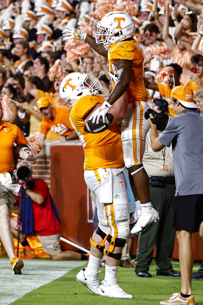 Tennessee running back Tiyon Evans (8) celebrates with offensive lineman Ollie Lane (78) during the second half of the team's NCAA college football game against Bowling Green on Thursday, Sept. 2, 2021, in Knoxville, Tenn. (AP Photo/Wade Payne)