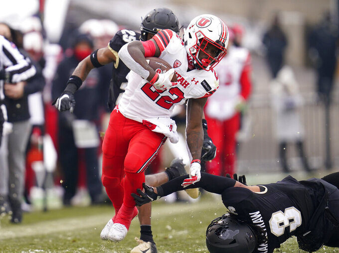 FILE - In this Dec. 12, 2020, file photo, Utah running back Ty Jordan avoids Colorado safety Derrion Rakestraw for a long gain in the second half of an NCAA college football game in Boulder, Colo. Utah opens the season against Weber State on Thursday. (AP Photo/David Zalubowski, File)
