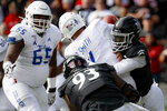 Tulsa quarterback Zach Smith (11) is sacked by Cincinnati defensive end Myjai Sanders (21) during the first half of an NCAA college football game, Saturday, Oct. 19, 2019, in Cincinnati. (AP Photo/John Minchillo)