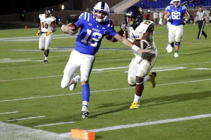 Duke quarterback Gunnar Holmberg (12) runs for a touchdown against North Carolina A&T linebacker Jacob Roberts (13) during the second half of an NCAA college football game in Durham, N.C., Friday, Sept. 10, 2021. (AP Photo/Chris Seward)