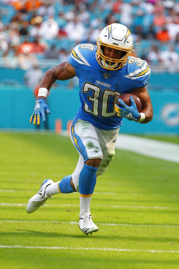 Los Angeles Chargers running back Austin Ekeler (30) runs for a touchdown, during the first half at an NFL football game against the Miami Dolphins, Sunday, Sept. 29, 2019, in Miami Gardens, Fla. (AP Photo/Wilfredo Lee)