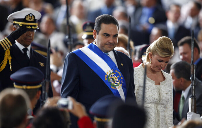 FILE - In this June 1, 2009 file photo, on his last day as president of El Salvador, Tony Saca and his wife, Ana Ligia de Saca, arrive to the inauguration ceremony for the new president of El Salvador, Mauricio Funes, in San Salvador. A court in El Salvador found ex-President Tony Saca guilty and his wife, Ana Ligia de Saca, guilty of illicit enrichment Tuesday, Jan. 5, 2021, and ordered them to repay the government $4.4 million. (AP Photo/Dario Lopez-Mills, File)