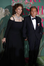 Designer Valentino Garavani, right, and actress Sophia Loren pose for photographers upon arrival at the Green Carpet Fashion Awards in Milan, Italy, Sunday, Sept. 22, 2019. (AP Photo/Luca Bruno)