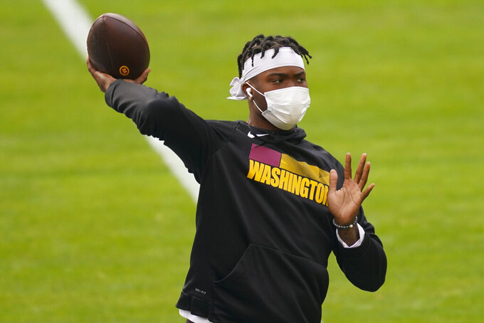 Washington Football Team quarterback Dwayne Haskins (7) throws in pregame warm-ups before the start of an NFL football game between against the Cincinnati Bengals, Sunday, Nov. 22, 2020, in Landover, Md. (AP Photo/Andrew Harnik)