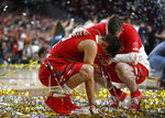 FILE - In this April 8, 2019, file photo, Texas Tech guard Davide Moretti, left, reacts with a teammate at the end of the championship game against Virginia in the Final Four NCAA college basketball tournament, in Minneapolis. The course of overtime changed when a Virginia player knocked the ball out of Texas Tech guard Davide Moretti's hands and sent the ball out of bounds. But the call was reversed when replay showed Moretti's finger had barely grazed the ball on its way out. (AP Photo/Jeff Roberson, File)