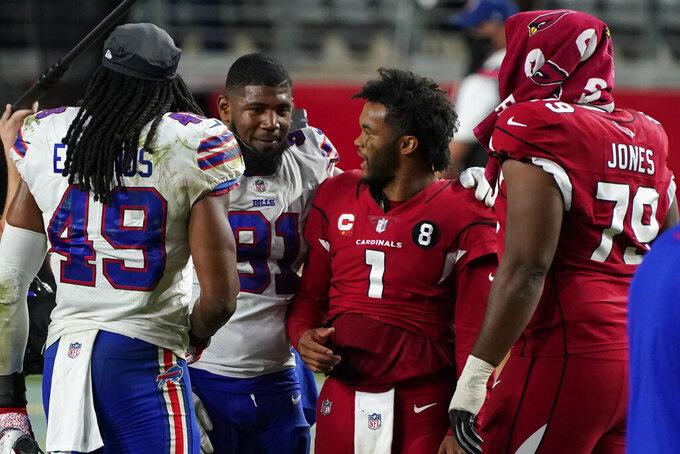 Arizona Cardinals quarterback Kyler Murray (1) and Buffalo Bills defensive tackle Ed Oliver meet at mid field an NFL football game, Sunday, Nov. 15, 2020, in Glendale, Ariz. The Cardinals won 32-20. (AP Photo/Rick Scuteri)