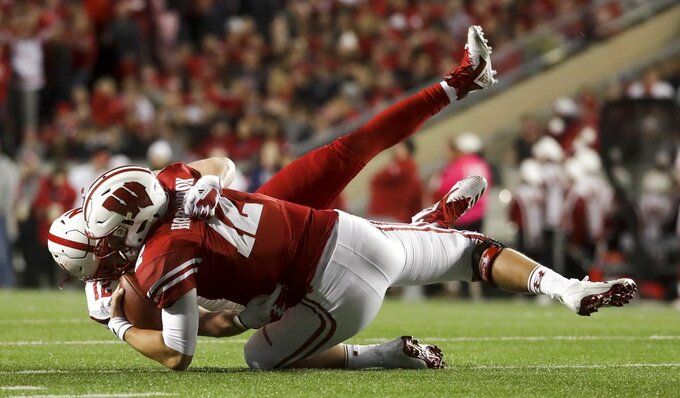 Wisconsin quarterback Alex Hornibrook is sacked by Nebraska's Luke Gifford during the first half of an NCAA college football game Saturday, Oct. 6, 2018, in Madison, Wis. (AP Photo/Morry Gash)