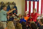 2020 Democratic presidential candidate Sen. Elizabeth Warren, D-Mass., listens as Kermit resident Dr. JW Endicott asks a question regarding inpatient and outpatient rehabilitation during a
