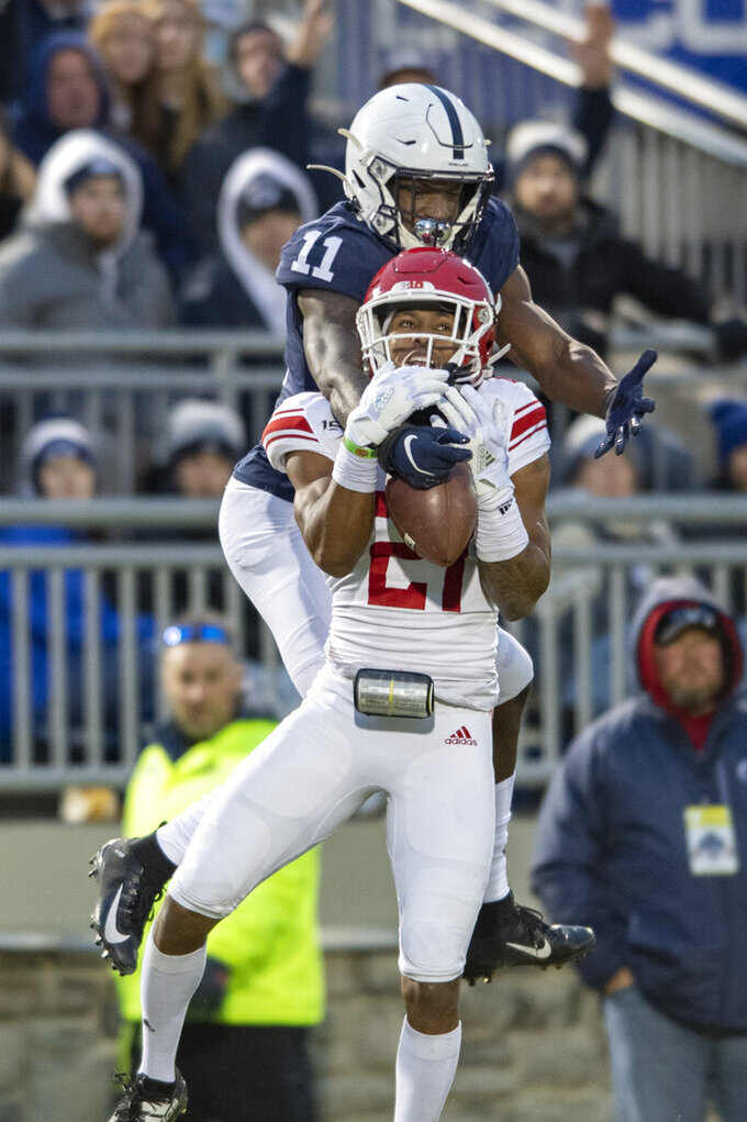Rutgers defensive back Tim Barrow (21) intercepts a pass intended for Penn State wide receiver Daniel George (11) in the second quarter of an NCAA college football game in State College, Pa., on Saturday, Nov. 30, 2019. (AP Photo/Barry Reeger)