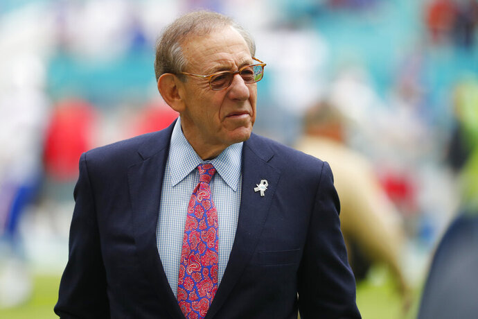 FILE - Miami Dolphins owner Stephen Ross watches his team warm up before an NFL football game against the Buffalo Bills, Sunday, Nov. 17, 2019, in Miami Gardens, Fla. The U.S. Justice Department has entered into a sports dispute involving the company of a longtime friend of President Donald Trump, warning FIFA that a prohibition against staging league matches internationally could violate American antitrust laws. Relevent Sports, controlled by Miami Dolphins owner Stephen Ross, sued the U.S. Soccer Federation in September 2019 for failing to sanction a proposed Spanish league match between Barcelona and Girona in Miami Gardens, Florida.(AP Photo/Wilfredo Lee, File)