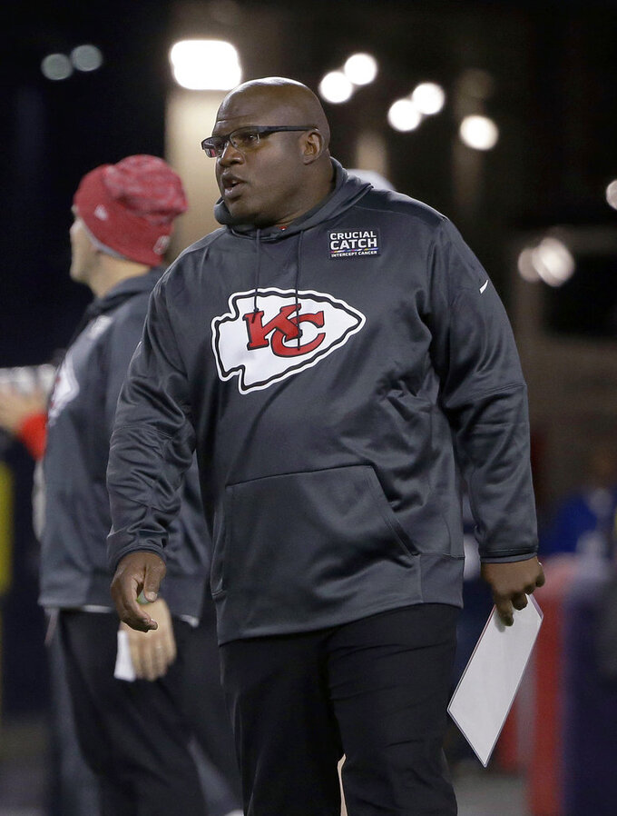 FILE - In this Oct. 14. 2018, file photo, Kansas City Chiefs offensive coordinator Eric Bieniemywalks on the field before the team's NFL football game against the New England Patriot, in Foxborough, Mass. It was Doug Pederson a couple years ago. Matt Nagy last year. Now, it's Eric Bieniemy that is juggling the roles of Chiefs offensive coordinator with the phone calls from teams searching for their next head coach. (AP Photo/Steven Senne, File)
