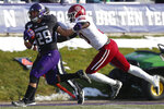 Northwestern's Evan Hull, left, is hit by Massachusetts' Claudin Cherrelus on his way to scoring a touchdown during the second half of an NCAA college football game Saturday, Nov. 16, 2019, in Evanston, Ill. (AP Photo/Jim Young)