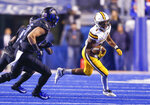 Wyoming running back Xazavian Valladay, right, runs past the Boise State defense during the first half of an NCAA college football game Saturday, Nov. 9, 2019, in Boise, Idaho. (AP Photo/Steve Conner)