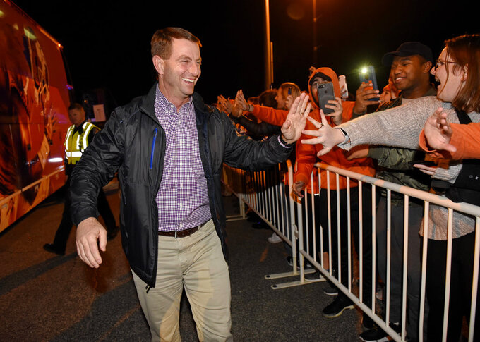 Clemson coach Dabo Swinney greets fans as the team returned to campus Tuesday, Jan. 8, 2019, in Clemson, S.C., the day after the Tigers defeated Alabama 44-16 in the College Football Playoff championship game. (AP Photo/Richard Shiro)