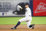 FILE - In this Sept. 19, 2019, file photo, New York Yankees' Brett Gardner gestures from second base after hitting an RBI double during the sixth inning of the teams' baseball game against the Los Angeles Angels in New York. Gardner is returning to the Yankees for a 14th season. The 37-year outfielder and New York agreed Friday to a $4 million, one-year contract, a person familiar with the negotiations told The Associated Press. (AP Photo/Mary Altaffer, File)