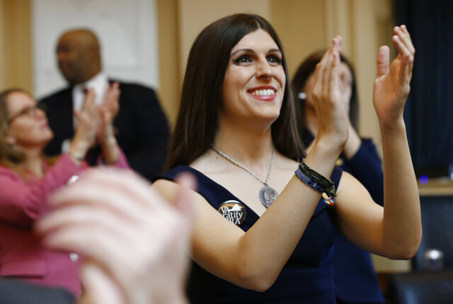 FILE - In this Jan. 9, 2019 file photo, Del. Danica Roem, D-Prince William, right, applauds visitors during opening ceremonies at the start of the 2019 session of the Virginia General Assembly in the House chambers at the Capitol in Richmond, Va.  Supporters of the Equal Rights Amendment are confident Virginia is on the verge of becoming the critical 38th state to ratify the gender equality measure.  The proposed 28th amendment to the U.S. Constitution faces a host of likely legal challenges and vehement opposition from conservative activists who depict the ERA as a threat to their stances on abortion and transgender rights.(AP Photo/Steve Helber)