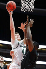 Hawaii center Dawson Carper, left, is fouled by Long Beach State center Temidayo Yussuf during first half of an NCAA college basketball game at the Big West men's tournament in Anaheim, Calif., Thursday, March 14, 2019. (AP Photo/Chris Carlson)