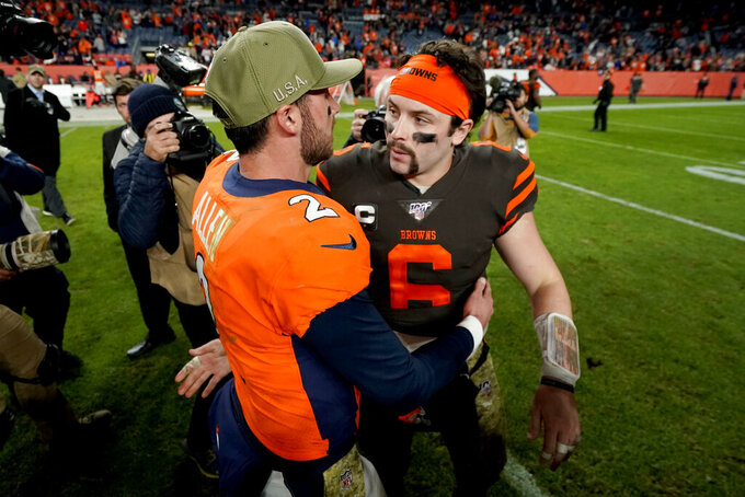Denver Broncos quarterback Brandon Allen (2) greets Cleveland Browns quarterback Baker Mayfield (6) after an NFL football game, Sunday, Nov. 3, 2019, in Denver. The Broncos won 24-19. (AP Photo/Jack Dempsey)