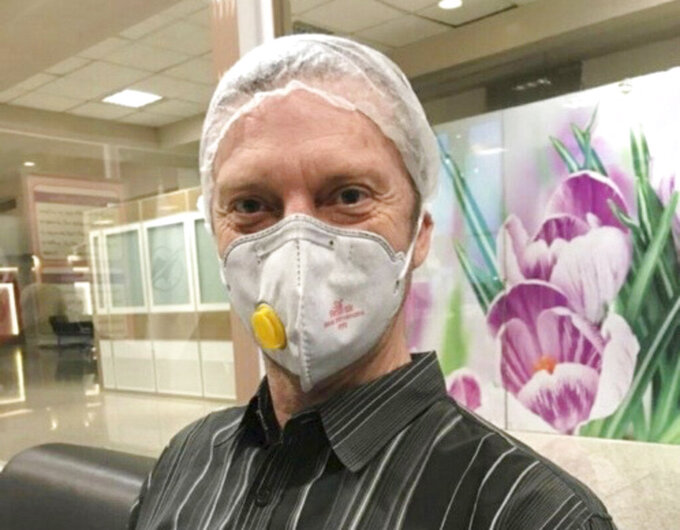 FILE - This March 19, 2020, file photo provided courtesy of the White family, shows U.S. Navy veteran Michael White in Mashhad, Iran. White, a Navy veteran detained in Iran for nearly two years, has been released and is on his way home as part of an unusual agreement to free an Iranian-American physician who was prosecuted in the United States, U.S. officials said Thursday, June 4. (Courtesy of the White Family via AP)