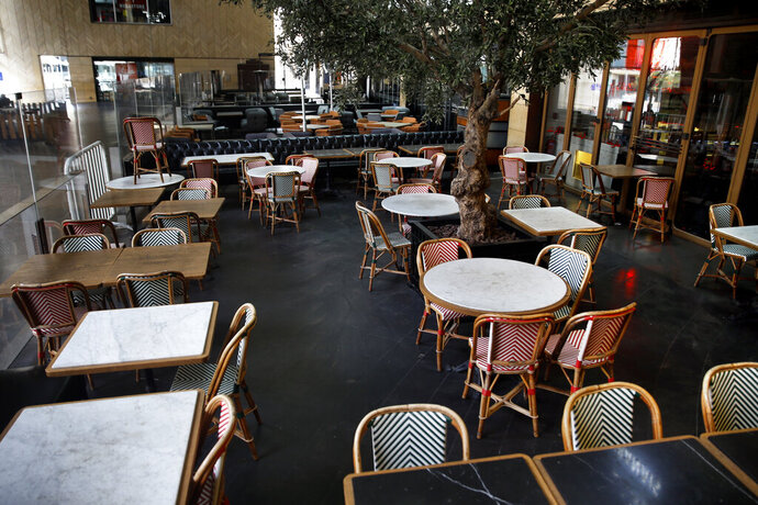 This Monday, March 16, 2020 photo, shows a closed restaurant after authorities ordered the closure, as part of the preventive measures against the coronavirus, in Beirut, Lebanon. The COVID-19 pandemic has managed to do what various wars could not: Close bars, restaurants and entertainment spots across the tiny Mediterranean country. (AP Photo/Bilal Hussein)