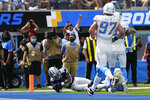 Dallas Cowboys running back Tony Pollard (20) scores a touchdown before an NFL football game against the Los Angeles Chargers Sunday, Sept. 19, 2021, in Inglewood, Calif. (AP Photo/Ashley Landis )