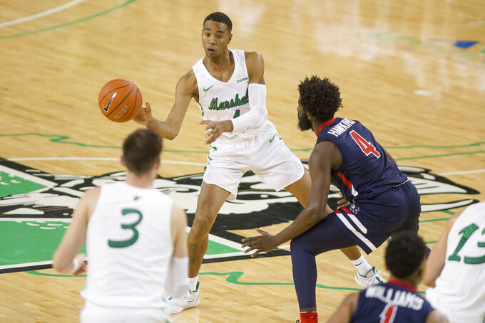 Marshall's Taevion Kinsey (1) makes a pass to teammate Jannson Williams (3) as he is guarded by Robert Morris' Jalen Hawkins (4) during an NCAA college basketball game Thursday, Nov. 7, 2019, in Huntington, W.Va. (Sholten Singer/The Herald-Dispatch via AP)