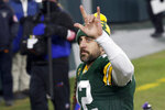 Green Bay Packers quarterback Aaron Rodgers waves to spectators after an NFL divisional playoff football game against the Los Angeles Rams Saturday, Jan. 16, 2021, in Green Bay, Wis. The Packers defeated the Rams 32-18 to advance to the NFC championship game. (AP Photo/Mike Roemer)