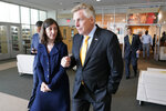 In this July 15, 2021, photo, Rep. Elaine Luria, D-Va., left, talks with Democratic gubernatorial candidate Terry McAuliffe, during a tour of Norfolk State University in Norfolk, Va. Republicans and Democrats have something in common when it comes to recruiting candidates they hope will deliver majorities in Congress after the 2022 election, and that's military veterans. (AP Photo/Steve Helber)