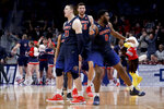Liberty forward Scottie James, left, and forward Myo Baxter-Bell, right, celebrate the team's win against Mississippi State in a first-round game in the NCAA men's college basketball tournament Friday, March 22, 2019, in San Jose, Calif. (AP Photo/Jeff Chiu)