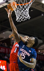 SMU forward Feron Hunt (1) goes up for a shot while defended by Connecticut forward Sidney Wilson (15) during the first half of an NCAA college basketball game Wednesday, Feb. 12, 2020, in Dallas. (Ashley Landis/The Dallas Morning News via AP)