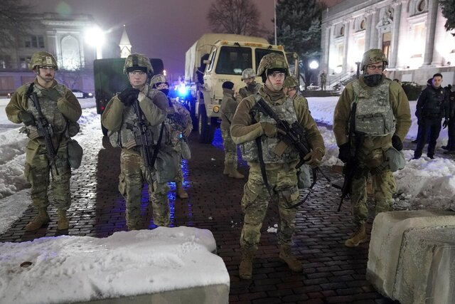 National Guard members stand outside a museum, late Tuesday, Jan. 5, 2021, in Kenosha, Wis. Earlier it was announced that no charges will be filed against the white police officer who shot Jacob Blake, a Black man, in August. (AP Photo/Morry Gash)