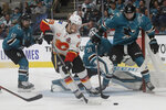 Calgary Flames left wing Matthew Tkachuk (19) skates against the San Jose Sharks during the second period of an NHL hockey game in San Jose, Calif., Sunday, Oct. 13, 2019. (AP Photo/Jeff Chiu)