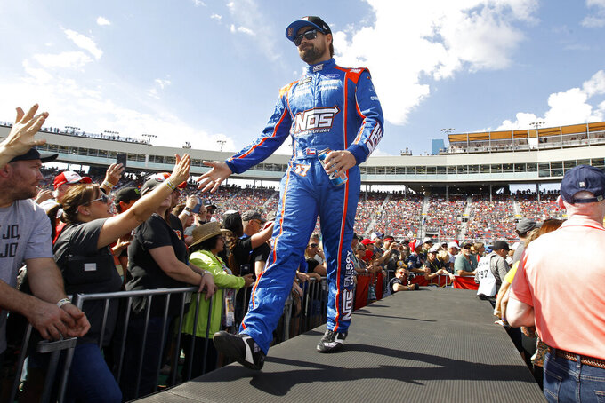 Ricky Stenhouse Jr. greets fans during driver introductions prior to the NASCAR Cup Series auto race at ISM Raceway, Sunday, Nov. 10, 2019, in Avondale, Ariz. (AP Photo/Ralph Freso)