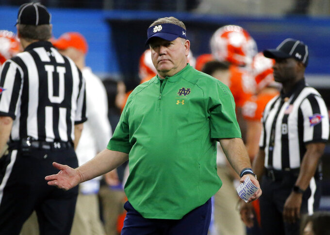 Notre Dame head coach Brian Kelly gestures while standing on the field before the NCAA Cotton Bowl semi-final playoff football game against Clemson on Saturday, Dec. 29, 2018, in Arlington, Texas. (AP Photo/Michael Ainsworth)