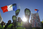 Yellow vest protesters demonstrate peacefully in downtown Marseille, southern France, Saturday, Jan. 12, 2019. Authorities deployed 80,000 security forces nationwide for a ninth straight weekend of anti-government protests. (AP Photo/Claude Paris)
