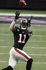 Atlanta Falcons wide receiver Julio Jones (11) works against the New Orleans Saints during the first half of an NFL football game, Sunday, Dec. 6, 2020, in Atlanta. (AP Photo/Brynn Anderson)