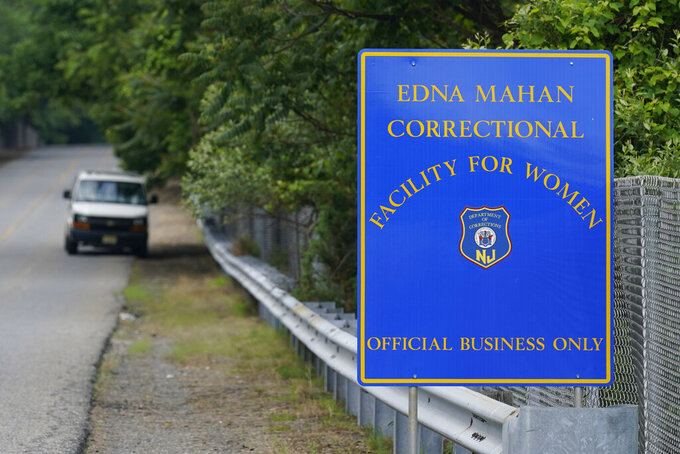 A sign is displayed near the Edna Mahan Correctional Facility for Women in Clinton, N.J., Tuesday, June 8, 2021. New Jersey's embattled corrections commissioner announced his resignation Tuesday, a day after Gov. Phil Murphy said the state would shutter its long-troubled and only women's prison. (AP Photo/Seth Wenig)