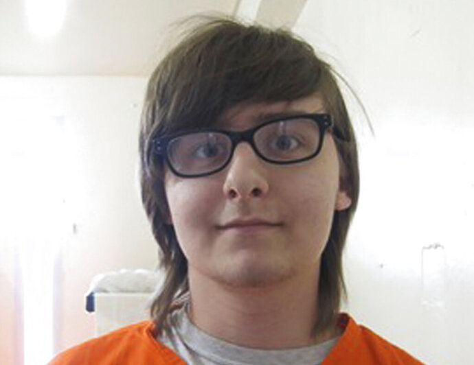 FILE - In this Aug. 6, 2018, file photo provided by the Oklahoma Department of Corrections, Robert Bever is pictured in Lexington, Okla. The Oklahoma Department of Corrections says Bever, serving life in prison for stabbing his parents and three of his siblings to death, tried to attack prison staff with an 8-inch long
