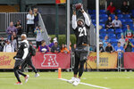 American Football Conference wide receiver DJ Chark, left, of the Jacksonville Jaguars, watches as AFC running back Mark Ingram, of the Baltimore Ravens, right, catches a pass during a practice for the NFL Pro Bowl football game Thursday, Jan. 23, 2020, in Kissimmee, Fla. (AP Photo/John Raoux)