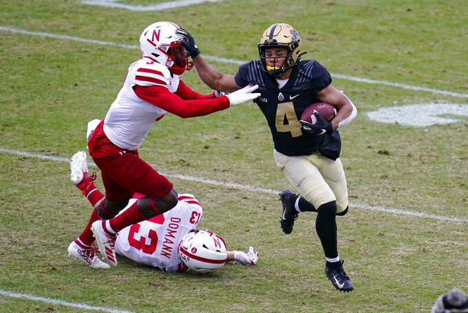 Purdue wide receiver Rondale Moore (4) holds off Nebraska linebacker Will Honas (3) during the first quarter of an NCAA college football game in West Lafayette, Ind., Saturday, Dec. 5, 2020. (AP Photo/Michael Conroy)