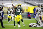 Green Bay Packers' Za'Darius Smith (55) celebrates a sack of Atlanta Falcons quarterback Matt Ryan, bottom right, during the second half of an NFL football game, Monday, Oct. 5, 2020, in Green Bay, Wis. (AP Photo/Mike Roemer)