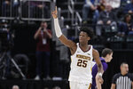 Minnesota's Daniel Oturu (25) reacts during the second half of an NCAA college basketball game against Northwestern at the Big Ten Conference tournament, Wednesday, March 11, 2020, in Indianapolis. Minnesota won 74-57. (AP Photo/Darron Cummings)