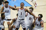 Gonzaga guard Jalen Suggs (1) celebrates making the game winning basket against UCLA during overtime in a men's Final Four NCAA college basketball tournament semifinal game, Saturday, April 3, 2021, at Lucas Oil Stadium in Indianapolis. Gonzaga won 93-90. (AP Photo/Michael Conroy)