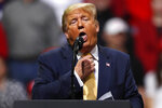 President Donald Trump acts as if he is choking to describe the Democratic debate performance of Michael Bloomberg as Trump speaks at a campaign rally Thursday, Feb. 20, 2020, in Colorado Springs, Colo. (AP Photo/David Zalubowski)